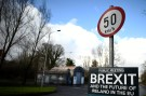A former customs hut is seen behind a Brexit sign between Donegal in the Republic of Ireland and Londonderry in Northern Ireland at the border village of Muff, Ireland, February 1, 2018. Picture taken February 1, 2018. REUTERS/Clodagh Kilcoyne - RC1196063CD0